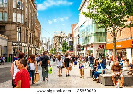 LIVERPOOL, UK - August 10, 2015: Pedestrians shop along the retail part of Liverpool in Church Street.
