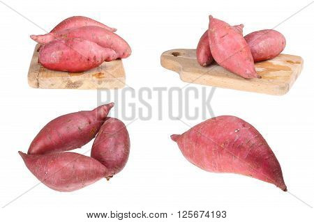 three sweet batatas on the isolated background
