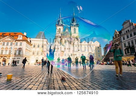 PRAGUE, CZECH REPUBLIC - OCTOBER 15, 2014: Unidentified young woman makes soap bubbles in Old Town Square - Staromestske namesti - in Prague, Czech Republic