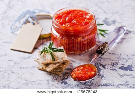 Homemade fresh salsa of tomato and pepper. Selective focus.