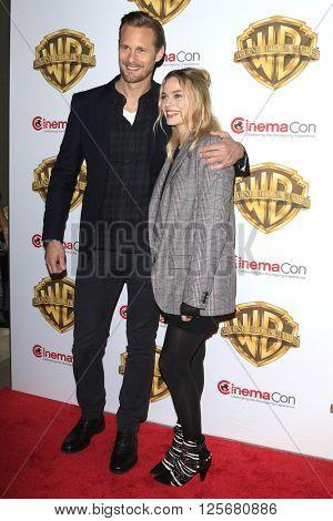 LAS VEGAS - APR 12: Alexander Skarsga?rd, Margot Robbie at the Warner Bros. Pictures Presentation during CinemaCon at Caesars Palace on April 12, 2016 in Las Vegas, Nevada