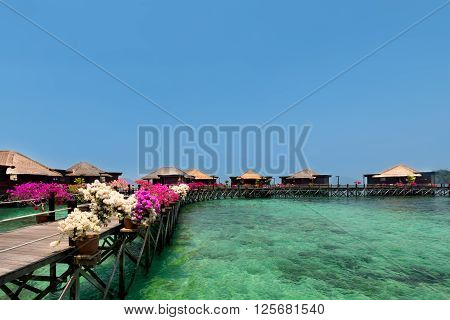 Overwater bungalows on tropical island.Beautiful view of water villas in resort.Summer vacation concept