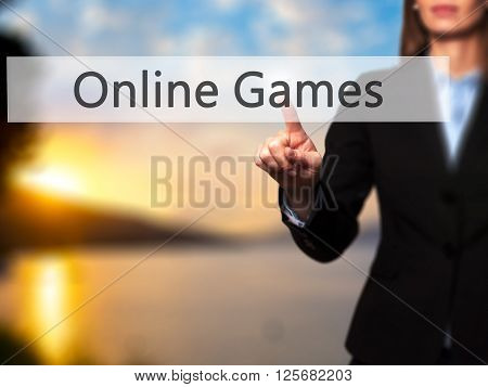 Online Games - Businesswoman Hand Pressing Button On Touch Screen Interface.
