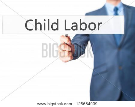 Child Labor - Businessman Hand Holding Sign