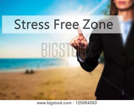 Stress Free Zone - Businesswoman Hand Pressing Button On Touch Screen Interface.