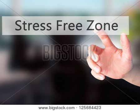 Stress Free Zone - Hand Pressing A Button On Blurred Background Concept On Visual Screen.