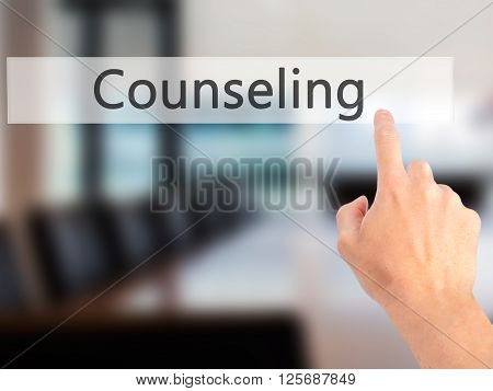 Counseling - Hand Pressing A Button On Blurred Background Concept On Visual Screen.