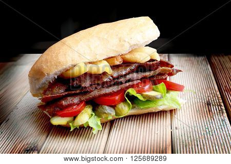 Grilled meat and vegetables in bread. Traditional turkish doner kebab.