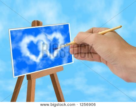 poster of hand with brush blue sky and heart-shaped clouds on easel
