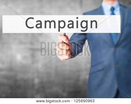 Campaign - Businessman Hand Holding Sign