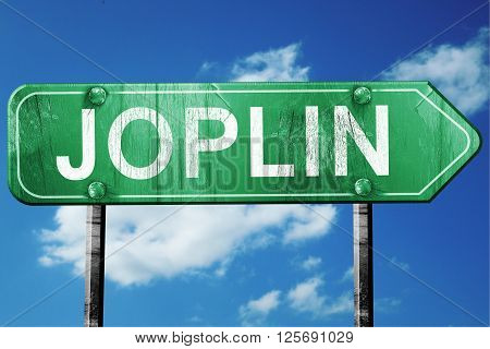 joplin road sign on a blue sky background