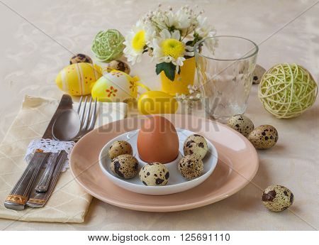 Easter table setting with quail eggs and flower