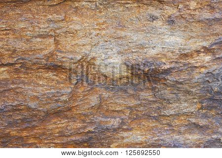 Red granite rock background texture close up