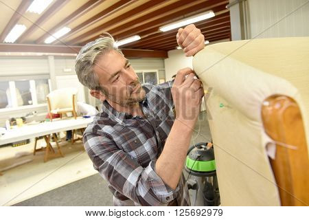 Man working in upholstery workshop