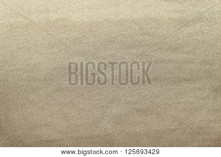 Light brown canvas fabric background texture close up
