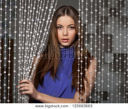 Beauty Portrait Of Attractive Woman With Bead Curtain
