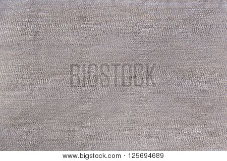 Light grey jeans background texture close up
