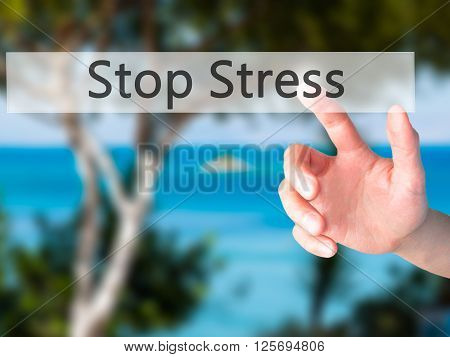 Stop Stress - Hand Pressing A Button On Blurred Background Concept On Visual Screen.