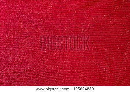 Red woolen sweater background texture close up
