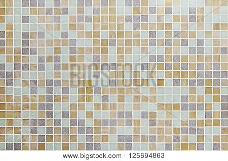 Colorful mosaic wall background texture close up