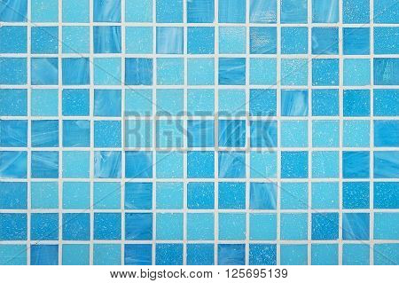 Blue mosaic wall background texture close up