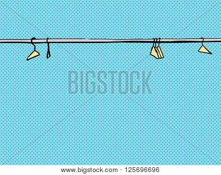 Empty Clothes Hangers On Rod