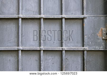 Old metal door background texture close up