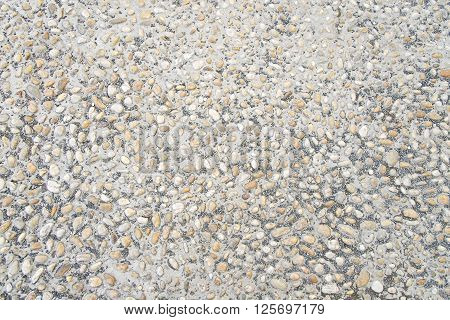 Grey stone pavement background texture close up