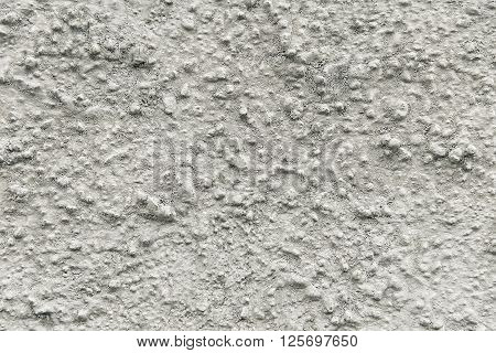 Old grey painted wall background texture close up