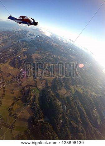 Man wingsuit sky diving over south Norway