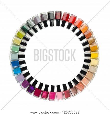 Nail polish colorful bottles circle isolated on white