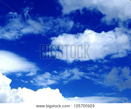 the white clouds on a sunny day of the month of April