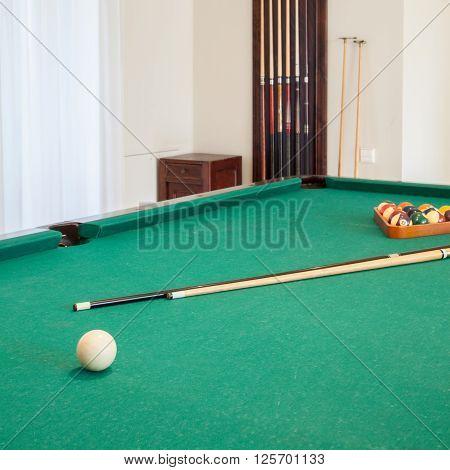 Billiard Cue On Billiard Table