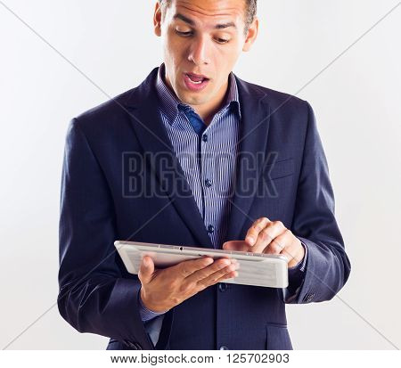 Man Holding A Tablet Checking His Finance