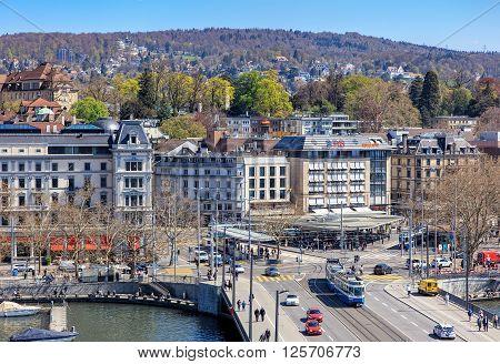 Zurich, Switzerland - 11 April, 2016: pedestrians and traffic on Quaibruecke bridge and Bellevue square view from the Ferris wheel temporarily installed on Burkliplatz square. Zurich is the largest city in Switzerland.