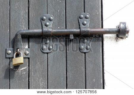 Old latch and padlock on wodeen door