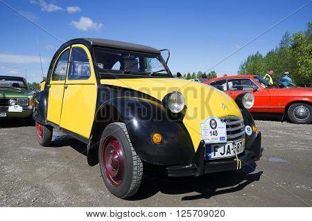 KERIMYAKI, FINLAND - JUNE 06, 2015: The ugly duckling Citroen 2CV at the parade of vintage cars