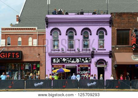 NASHVILLE,TN,USA - SEP 27, 2015: Honky tonk Bars on historical Broadway in downtown Nashville, Tennessee, USA. Lower Broadway is famous for entertainment district of country music.