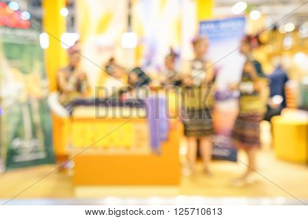 Defocused bokeh abstract of generic trade show expo stand - Concept of business social gathering for international tradeshow of tourism meeting exchange - Warm overexposed saturated filter