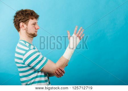 Man With Hand In Bandage.