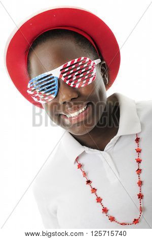 Close-up of a pretty tween girl dressed to celebrate America with red, white and blue louvered sun glasses.  On a white background.