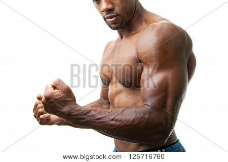 Ripped and muscular martial artist flexing his muscles isolated over a white background. poster