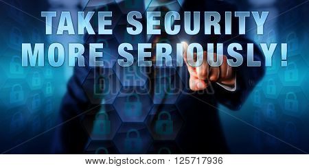Security director is pressing TAKE SECURITY MORE SERIOUSLY! on a virtual touch screen interface. Business challenge metaphor and information security concept. Call to action for IT professionals.