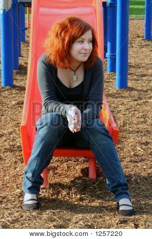 Teen Thinking On Sliding Board