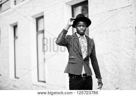 Fashion Portrait Of Black African American Man On Green Velvet Jacket And Black Hat Walking On Stree