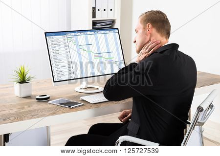 Businessman Suffering From Neck Ache