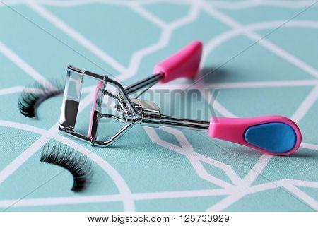 Curler and false eyelashes, close up