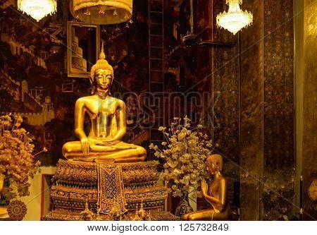 Bangkok, Thailand - December 6, 2015: Golden Buddha statues in a Thai Buddhist temple, Wat Phra Borommathat Maha Chedi, Bangkok, Thailand.