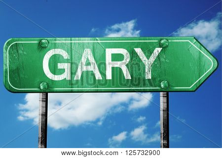 gary road sign on a blue sky background