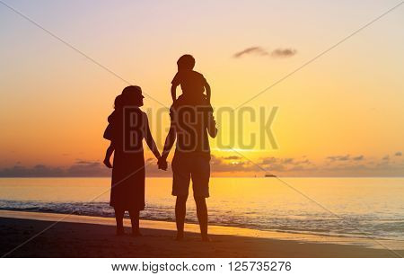 happy family with two kids having fun at sunset beach